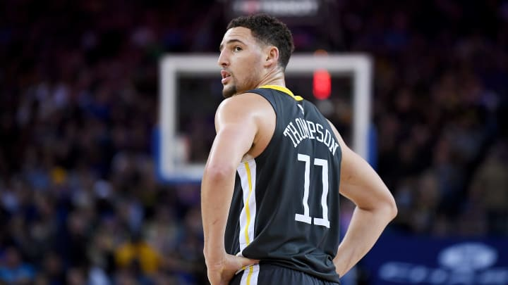 OAKLAND, CA – FEBRUARY 10: Klay Thompson, who wears No. 11 to signify his spot in the 2011 NBA Draft, looks on against the San Antonio Spurs at ORACLE Arena. (Photo by Thearon W. Henderson/Getty Images)