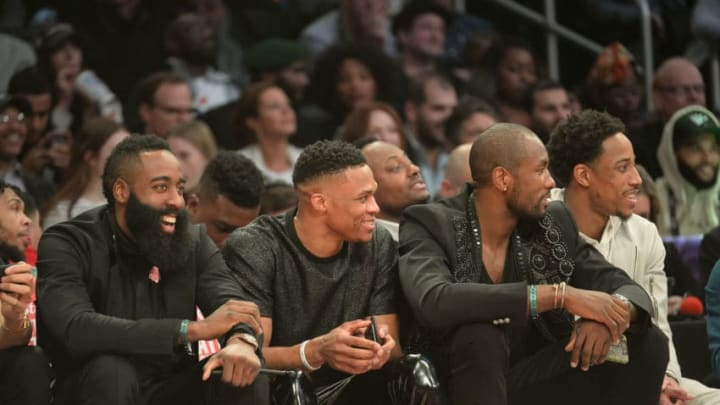 LOS ANGELES, CA - FEBRUARY 17: (L-R) James Harden, Russell Westbrook, Serge Ibaka and DeMar Derozan of the San Antonio Spurs attend the 2018 Verizon Slam Dunk Contest at Staples Center on February 17, 2018 in Los Angeles, California. (Photo by Kevork Djansezian/Getty Images)