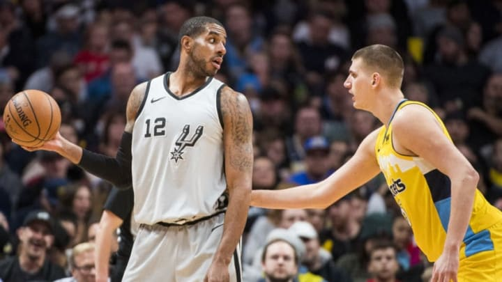 DENVER, CO - FEBRUARY 23: LaMarcus Aldridge #12 of the San Antonio Spurs looks for an open teammate over Nikola Jokic #15 of the Denver Nuggets (Photo by Timothy Nwachukwu/Getty Images)