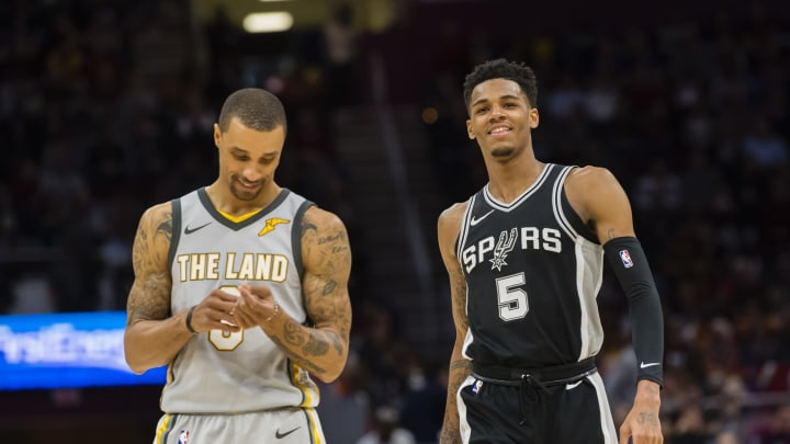 CLEVELAND, OH – FEBRUARY 25: George Hill #3 of the Cleveland Cavaliers and Dejounte Murray #5 of the San Antonio Spurs talk during the second half at Quicken Loans Arena Photo by Jason Miller/Getty Images)