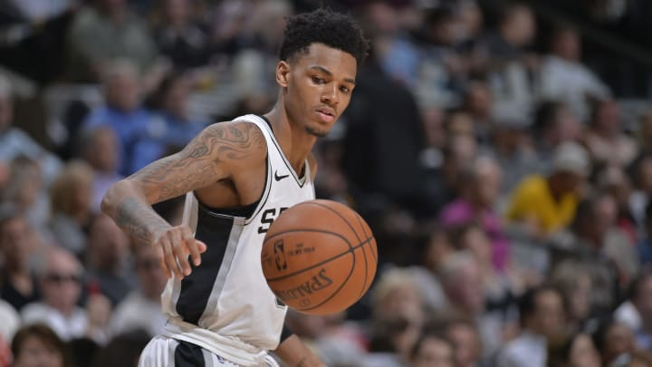 SAN ANTONIO, TX – FEBRUARY 28: Dejounte Murray #5 of the San Antonio Spurs grabs a loose ball during the game against the New Orleans Pelicans (Photos by Mark Sobhani/NBAE via Getty Images)