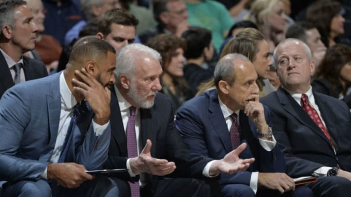 SAN ANTONIO, TX - JANUARY 26: Coaches Ime Udoka of the San Antonio Spurs, Gregg Popovich of the San Antonio Spurs, and Ettore Messina of the San Antonio Spurs speak during the game against the Philadelphia 76ers on January 26, 2018 at the AT&T Center in San Antonio, Texas. NOTE TO USER: User expressly acknowledges and agrees that, by downloading and or using this photograph, user is consenting to the terms and conditions of the Getty Images License Agreement. Mandatory Copyright Notice: Copyright 2018 NBAE (Photos by Mark Sobhani/NBAE via Getty Images)