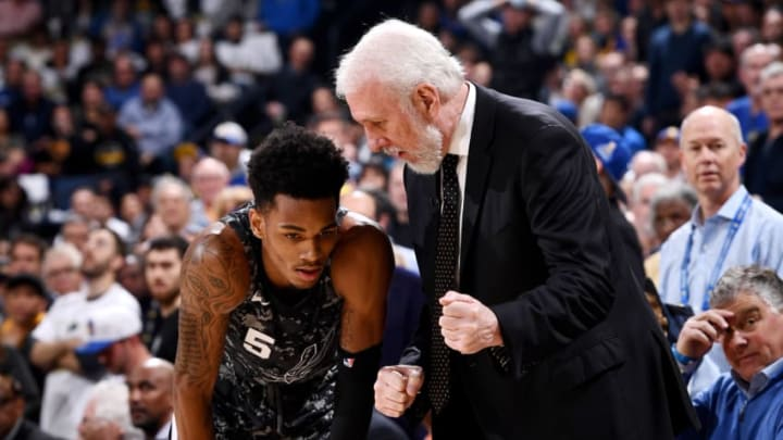 OAKLAND, CA - MARCH 8: Dejounte Murray #5 and Head Coach Gregg Popovich of the San Antonio Spurs talk during the game against the Golden State Warriors on March 8, 2018 at ORACLE Arena in Oakland, California. NOTE TO USER: User expressly acknowledges and agrees that, by downloading and or using this photograph, user is consenting to the terms and conditions of Getty Images License Agreement. Mandatory Copyright Notice: Copyright 2018 NBAE (Photo by Garrett Ellwood/NBAE via Getty Images)