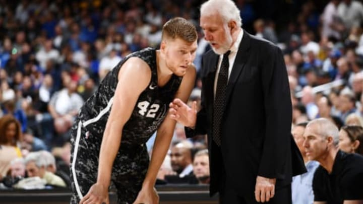 OAKLAND, CA – MARCH 8: Davis Bertans #42 and Head Coach Gregg Popovich of the San Antonio Spurs talk during the game against the Golden State Warriors on March 8, 2018 at ORACLE Arena in Oakland, California. NOTE TO USER: User expressly acknowledges and agrees that, by downloading and or using this photograph, user is consenting to the terms and conditions of Getty Images License Agreement. Mandatory Copyright Notice: Copyright 2018 NBAE (Photo by Garrett Ellwood/NBAE via Getty Images)
