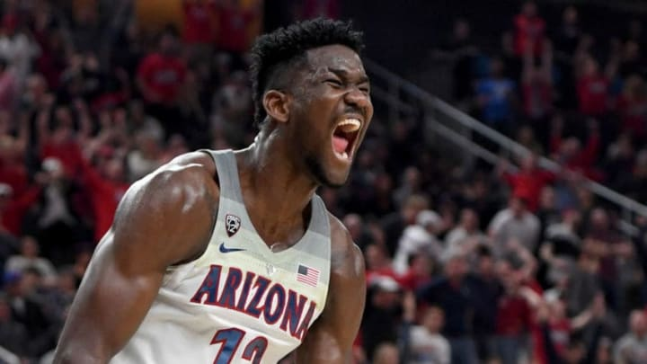 LAS VEGAS, NV - MARCH 10: Deandre Ayton #13 of the Arizona Wildcats reacts after dunking against the USC Trojans during the championship game of the Pac-12 basketball tournament at T-Mobile Arena on March 10, 2018 in Las Vegas, Nevada. The Wildcats won 75-61. (Photo by Ethan Miller/Getty Images)