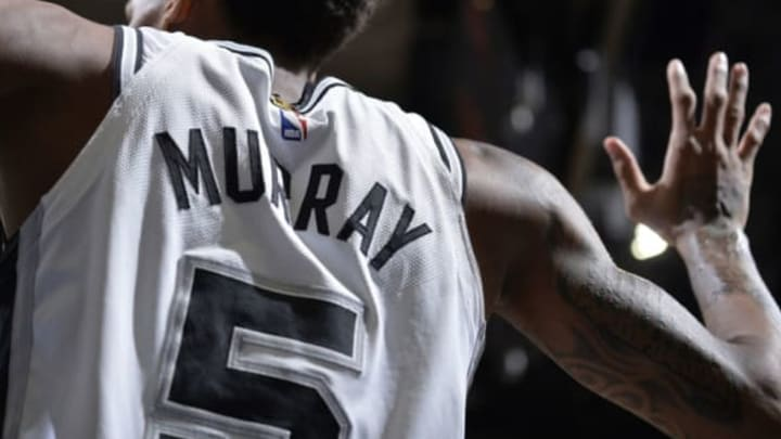 SAN ANTONIO, TX – MARCH 13: The jersey of Dejounte Murray #5 of the San Antonio Spurs as seen during the game against the Orlando Magic on March 13, 2018 at the AT&T Center in San Antonio, Texas. NOTE TO USER: User expressly acknowledges and agrees that, by downloading and or using this photograph, user is consenting to the terms and conditions of the Getty Images License Agreement. Mandatory Copyright Notice: Copyright 2018 NBAE (Photos by Mark Sobhani/NBAE via Getty Images)