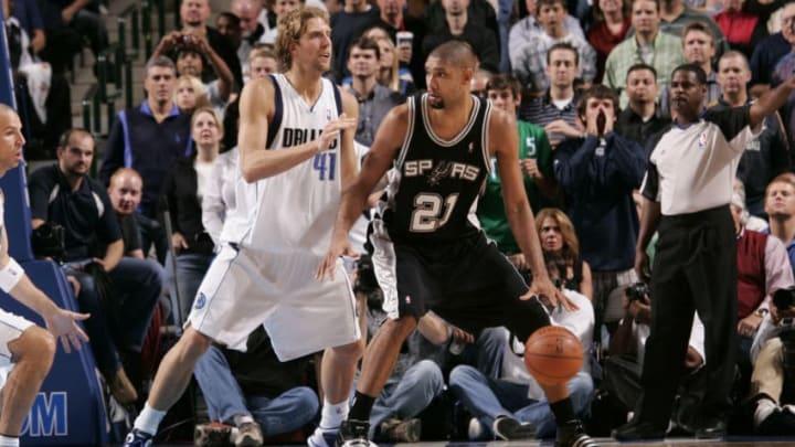 DALLAS - NOVEMBER 18: Tim Duncan of the San Antonio Spurs posts up against Dirk Nowitzki. (Photo by Glenn James/NBAE via Getty Images)