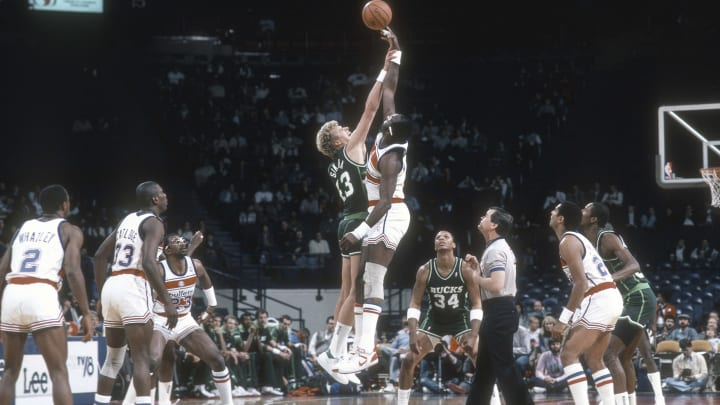 LANDOVER, MD – CIRCA 1986: Jack Sikma #43 of the Milwaukee Bucks battles for the tip-off with Moses Malone #4 of the Washington Bullets. (Photo by Focus on Sport/Getty Images) *** Local Caption *** Jack Sikma; Moses Malone