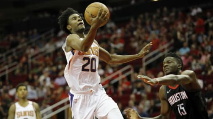 HOUSTON, TX – MARCH 30: Josh Jackson #20 of the Phoenix Suns goes up for a lay up defended by Clint Capela #15 of the Houston Rockets in the first half at Toyota Center on March 30, 2018 in Houston, Texas. NOTE TO USER: User expressly acknowledges and agrees that, by downloading and or using this photograph, User is consenting to the terms and conditions of the Getty Images License Agreement. (Photo by Tim Warner/Getty Images)