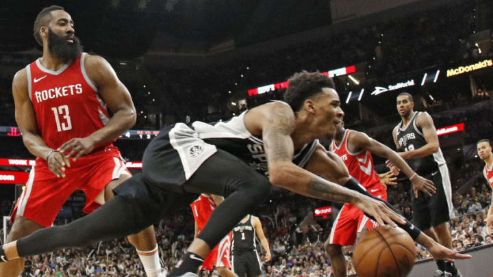 SAN ANTONIO,TX - APRIL 1 : Dejounte Murray #5 of the San Antonio Spurs reaches of the ball after being fouled by James Harden #13 of the Houston Rockets at AT&T Center (Photo by Ronald Cortes/Getty Images)