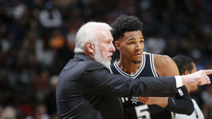 SAN ANTONIO, TX - APRIL 1: Head Coach Gregg Popovich of the San Antonio Spurs talks with Dejounte Murray #5 of the San Antonio Spurs (Photos by Chris Covatta/NBAE via Getty Images)