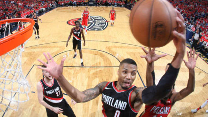 NEW ORLEANS, LA – APRIL 21: Damian Lillard #0 of the Portland Trail Blazers goes up for a rebound against the New Orleans Pelicans in Game Four of Round One of the 2018 NBA Playoffs on April 21, 2018 at Smoothie King Center in New Orleans, Louisiana. NOTE TO USER: User expressly acknowledges and agrees that, by downloading and or using this Photograph, user is consenting to the terms and conditions of the Getty Images License Agreement. Mandatory Copyright Notice: Copyright 2018 NBAE (Photo by Layne Murdoch/NBAE via Getty Images)