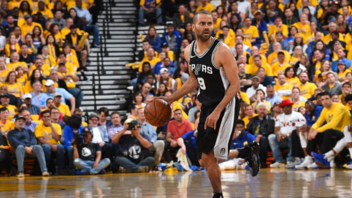 OAKLAND, CA - APRIL 24: Tony Parker #9 of the San Antonio Spurs handles the ball against the Golden State Warriors in Game Five of Round One of the 2018 NBA Playoffs on April 24, 2018 at ORACLE Arena in Oakland, California. NOTE TO USER: User expressly acknowledges and agrees that, by downloading and or using this photograph, user is consenting to the terms and conditions of Getty Images License Agreement. Mandatory Copyright Notice: Copyright 2018 NBAE (Photo by Andrew D. Bernstein/NBAE via Getty Images)