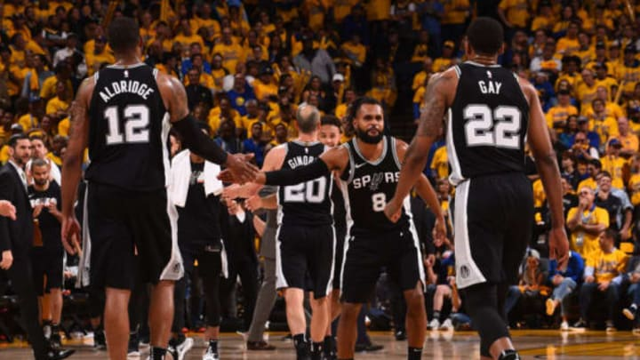 OAKLAND, CA – APRIL 24: LaMarcus Aldridge #12 of the San Antonio Spurs and Patty Mills #8 of the San Antonio Spurs exchange a high give against the Golden State Warriors in Game Five of Round One of the 2018 NBA Playoffs on April 24, 2018 at ORACLE Arena in Oakland, California. NOTE TO USER: User expressly acknowledges and agrees that, by downloading and or using this photograph, user is consenting to the terms and conditions of Getty Images License Agreement. Mandatory Copyright Notice: Copyright 2018 NBAE (Photo by Noah Graham/NBAE via Getty Images)