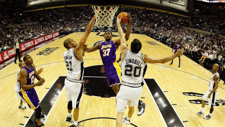 SAN ANTONIO – JANUARY 12: Forward Ron Artest #37 of the Los Angeles Lakers drives vs. Tim Duncan #21 and Manu Ginobili #20 of the San Antonio Spurs on January 12, 2010, at AT&T Center. (Photo by Ronald Martinez/Getty Images)