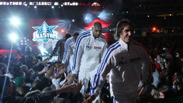 ARLINGTON, TX - FEBRUARY 14: Steve Nash #13, Tim Duncan #21 of the San Antonio Spurs and other members of the Western Conference shake hands with fans during introductions before the NBA All-Star Game, part of 2010 NBA All-Star Weekend at Cowboys Stadium on February 14, 2010 in Arlington, Texas. The Eastern Conference defeated the Western Conference 141-139 in regulation. NOTE TO USER: User expressly acknowledges and agrees that, by downloading and or using this photograph, User is consenting to the terms and conditions of the Getty Images License Agreement. (Photo by Jed Jacobsohn/Getty Images)