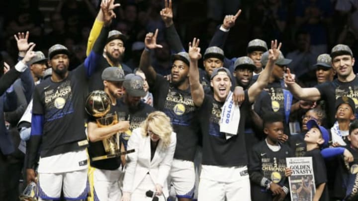 CLEVELAND, CA – JUN 8: the Golden State Warriors pose with the Larry O'Brien Championship trophy after defeating the Cleveland Cavaliers in Game Four of the 2018 NBA Finals won 108-85 by the Golden State Warriors over the Cleveland Cavaliers at the Quicken Loans Arena on June 6, 2018 in Cleveland, Ohio. NOTE TO USER: User expressly acknowledges and agrees that, by downloading and or using this photograph, User is consenting to the terms and conditions of the Getty Images License Agreement. Mandatory Copyright Notice: Copyright 2018 NBAE (Photo by Chris Elise/NBAE via Getty Images)