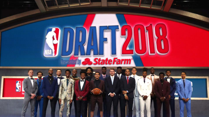 NEW YORK, NY – JUNE 21: (L-R) Donte DiVincenzo, Jerome Robinson, Mikal Bridges, Kevin Knox, Shai Gilgeous-Alexander, Wendell Carter Jr., Collin Sexton, Marvin Bagley III, Trae Young, Deandre Ayton, Luka Doncic, Miles Bridges, Michael Porter Jr., Lonnie Walker IV, Jaren Jackson, Aaron Holiday, Chandler Hutchison and Zhaire Smith pose for a photo before the 2018 NBA Draft at the Barclays Center on June 21, 2018, in the Brooklyn borough of New York City. (Photo by Mike Stobe/Getty Images)