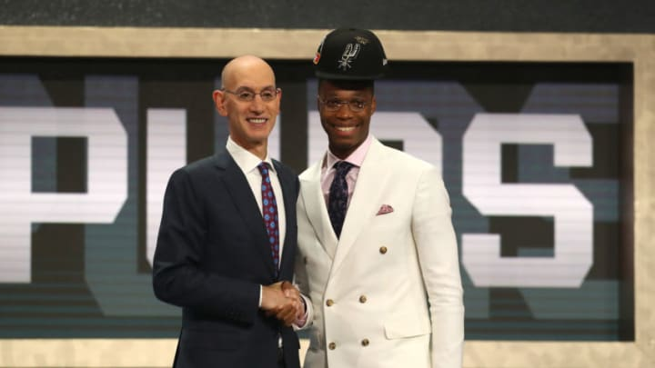 NEW YORK, NY - JUNE 21: Lonnie Walker IV poses with NBA Commissioner Adam Silver after being drafted 18th overall by the San Antonio Spurs during the 2018 NBA Draft (Photo by Mike Stobe/Getty Images)