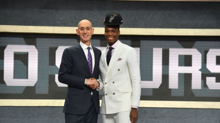 BROOKLYN, NY - JUNE 21: Lonnie Walker IV shakes hands with NBA Commissioner Adam Silver after being selected number eighteen overall by the San Antonio Spurs during the 2018 NBA Draft on June 21, 2018 at Barclays Center in Brooklyn, New York. NOTE TO USER: User expressly acknowledges and agrees that, by downloading and or using this photograph, User is consenting to the terms and conditions of the Getty Images License Agreement. Mandatory Copyright Notice: Copyright 2018 NBAE (Photo by Jesse D. Garrabrant/NBAE via Getty Images)