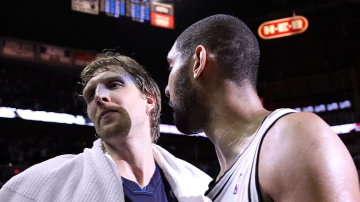 SAN ANTONIO – APRIL 29: Forward Tim Duncan #21 of the San Antonio Spurs greets Dirk Nowitzki #41 of the Dallas Mavericks after Game 6 of the Western Conference Quarterfinals in 2010 (Photo by Ronald Martinez/Getty Images)