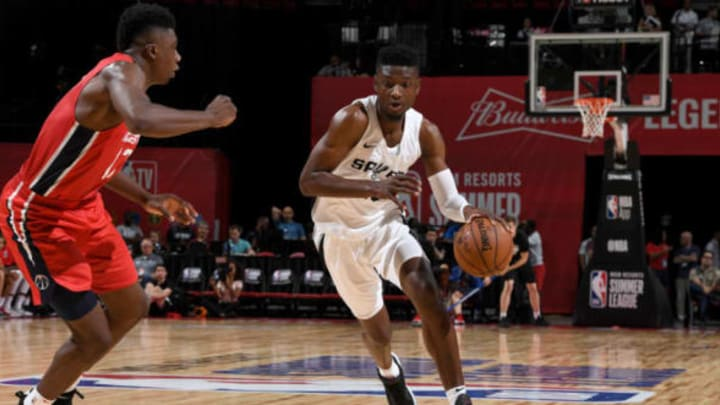 LAS VEGAS, NV – JULY 8: Chimezie Metu #10 of the San Antonio Spurs handles the ball against the Washington Wizards during the 2018 Las Vegas Summer League on July 8, 2018 at the Thomas & Mack Center in Las Vegas, Nevada. NOTE TO USER: User expressly acknowledges and agrees that, by downloading and/or using this Photograph, user is consenting to the terms and conditions of the Getty Images License Agreement. Mandatory Copyright Notice: Copyright 2018 NBAE (Photo by Garrett Ellwood/NBAE via Getty Images)