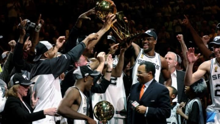 SAN ANTONIO – JUNE 15: The San Antonio Spurs hold the 2003 NBA Finals Champtionshiop Trophy after defeating the New Jersey Nets in Game six of the 2003 NBA Finals at SBC Center on June 15, 2003 in San Antonio, Texas. The Spurs won 88-77 to beat the Nets and win the NBA Championships. NOTE TO USER: User expressly acknowledges and agrees that, by downloading and/or using this Photograph, User is consenting to the terms and conditions of the Getty Images License Agreement. Mandatory Copyright Notice: Copyright 2003 NBAE (Photo by Noah Graham/NBAE via Getty Images)