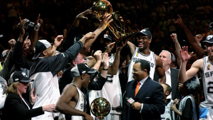 SAN ANTONIO - JUNE 15: The San Antonio Spurs hold the 2003 NBA Finals Champtionshiop Trophy after defeating the New Jersey Nets in Game six of the 2003 NBA Finals at SBC Center on June 15, 2003 in San Antonio, Texas. The Spurs won 88-77 to beat the Nets and win the NBA Championships. NOTE TO USER: User expressly acknowledges and agrees that, by downloading and/or using this Photograph, User is consenting to the terms and conditions of the Getty Images License Agreement. Mandatory Copyright Notice: Copyright 2003 NBAE (Photo by Noah Graham/NBAE via Getty Images)