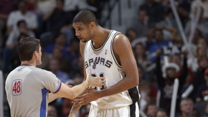 SAN ANTONIO - DECEMBER 3: Tim Duncan #21 of the San Antonio Spurs talks with official Scott Foster #48 during the game against the Los Angeles Lakers at the SBC Center on December 3, 2003 in San Antonio, Texas. The Lakers won 90-86. NOTE TO USER: User expressly acknowledges and agrees that, by downloading and/or using this Photograph, User is consenting to the terms and conditions of the Getty Images License Agreement (Photo by Garrett Ellwood/NBAE via Getty Images)