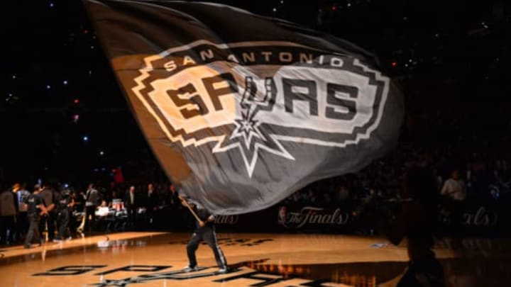 SAN ANTONIO, TX – JUNE 5: Mascot of the San Antonio Spurs holds the logo up during a timeout against the Miami Heat during Game One of the 2014 NBA Finals on June 5, 2014 at AT