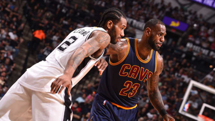 SAN ANTONIO, TX - MARCH 27: LeBron James #23 of the Cleveland Cavaliers and Kawhi Leonard #2 of the San Antonio Spurs fight for position during a game on March 27, 2017 at the AT&T Center in San Antonio, Texas. NOTE TO USER: User expressly acknowledges and agrees that, by downloading and or using this photograph, user is consenting to the terms and conditions of the Getty Images License Agreement. Mandatory Copyright Notice: Copyright 2017 NBAE (Photos by Noah Graham/NBAE via Getty Images)