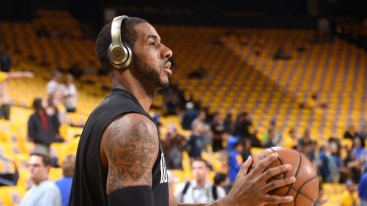 OAKLAND, CA - MAY 14: LaMarcus Aldridge #12 of the San Antonio Spurs warms up before the game against the Golden State Warriors in Game One of the Western Conference Finals of the 2017 NBA Playoffs on May 14, 2017 at ORACLE Arena in Oakland, California. NOTE TO USER: User expressly acknowledges and agrees that, by downloading and/or using this Photograph, user is consenting to the terms and conditions of the Getty Images License Agreement. Mandatory Copyright Notice: Copyright 2017 NBAE (Photo by Andrew D. Bernstein/NBAE via Getty Images)