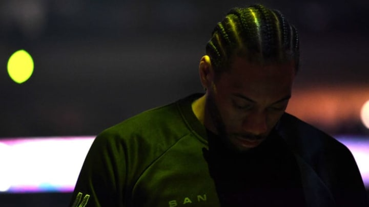 OAKLAND, CA - MAY 14: Kawhi Leonard #2 of the San Antonio Spurs stands during player introductions prior to Game One of the NBA Western Conference Finals against the Golden State Warriorsc at ORACLE Arena on May 14, 2017 in Oakland, California. NOTE TO USER: User expressly acknowledges and agrees that, by downloading and or using this photograph, User is consenting to the terms and conditions of the Getty Images License Agreement. (Photo by Thearon W. Henderson/Getty Images)