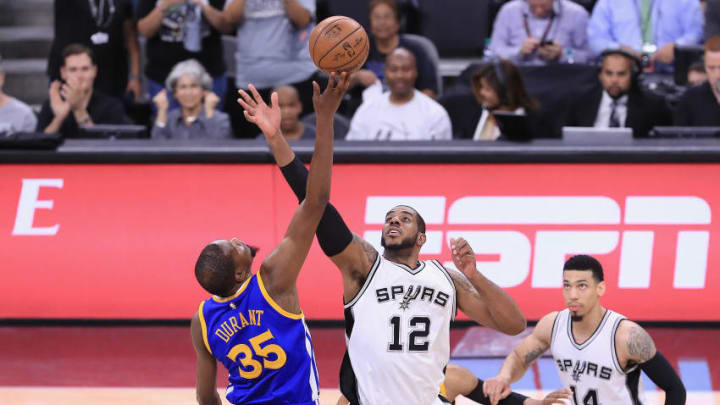 SAN ANTONIO, TX - MAY 22: Kevin Durant #35 of the Golden State Warriors and LaMarcus Aldridge #12 of the San Antonio Spurs battle for the opening tipoff during Game Four of the 2017 NBA Western Conference Finals at AT&T Center on May 22, 2017 in San Antonio, Texas. NOTE TO USER: User expressly acknowledges and agrees that, by downloading and or using this photograph, User is consenting to the terms and conditions of the Getty Images License Agreement. (Photo by Ronald Martinez/Getty Images)