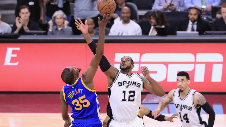 SAN ANTONIO, TX – MAY 22: Kevin Durant #35 of the Golden State Warriors and LaMarcus Aldridge #12 of the San Antonio Spurs battle for the opening tipoff during Game Four of the 2017 NBA Western Conference Finals at AT&T Center on May 22, 2017 in San Antonio, Texas. NOTE TO USER: User expressly acknowledges and agrees that, by downloading and or using this photograph, User is consenting to the terms and conditions of the Getty Images License Agreement. (Photo by Ronald Martinez/Getty Images)