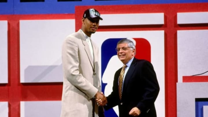 CHARLOTTE, NC – JUNE 25: Tim Duncan taken number one overall by the San Antonio Spurs shakes NBA Commissioner David Stern's hand during the 1997 NBA Draft on June 25, 1997 at the Charlotte Coliseum in Charlotte, North Carolina. NOTE TO USER: User expressly acknowledges and agrees that, by downloading and or using this Photograph, user is consenting to the terms and conditions of the Getty Images License Agreement. Mandatory Copyright Notice: Copyright 1997 NBAE (Photo by Nathaniel S. Butler/NBAE via Getty Images)