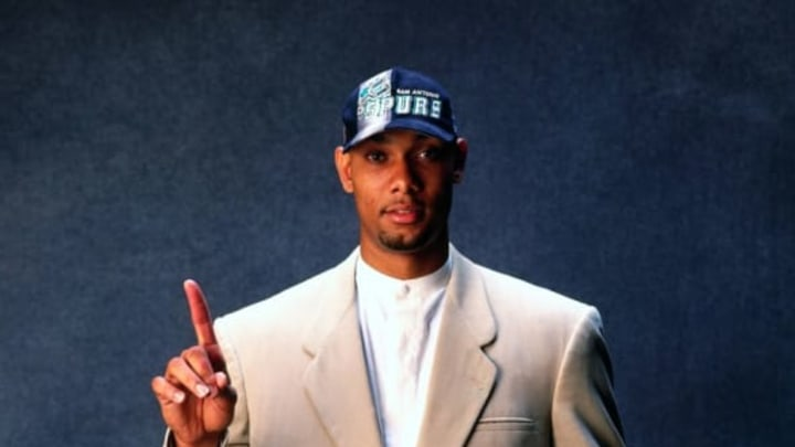 NEW YORK – 1997: Tim Duncan poses for a photo after being selected by the San Antonio Spurs at the 1997 NBA Draft in New York, New York. NOTE TO USER: User expressly acknowledges that, by downloading and or using this photograph, User is consenting to the terms and conditions of the Getty Images License agreement. Mandatory Copyright Notice: Copyright 1997 NBAE (Photo by Andy Hayt/NBAE via Getty Images)