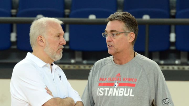 ISTANBUL, TURKEY - OCTOBER 10: Head Coach Gregg Popovich and General Manager R.C. Buford of the San Antonio Spurs talk during practice as part of the NBA Global Games on October 10, 2014 at the Darussafaka Practice Facility in Istanbul, Turkey. NOTE TO USER: User expressly acknowledges and agrees that, by downloading and or using this Photograph, user is consenting to the terms and conditions of the Getty Images License Agreement. Mandatory Copyright Notice: Copyright 2014 NBAE (Photo by Garrett Ellwood/NBAE via Getty Images)