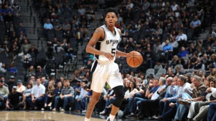 SAN ANTONIO, TX – MARCH 1: Dejounte Murray #5 of the San Antonio Spurs handles the ball against the Indiana Pacers during the game on March 1, 2017 at the AT&T Center in San Antonio, Texas. NOTE TO USER: User expressly acknowledges and agrees that, by downloading and or using this photograph, user is consenting to the terms and conditions of the Getty Images License Agreement. Mandatory Copyright Notice: Copyright 2017 NBAE (Photos by Mark Sobhani/NBAE via Getty Images)