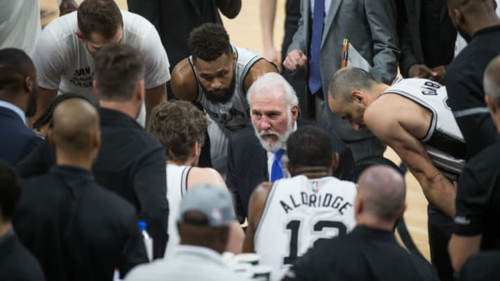 SAN ANTONIO, TX - MARCH 27: Gregg Popovich of the San Antonio Spurs talks with his team during the game against the Cleveland Cavaliers on March 27, 2017 at the AT
