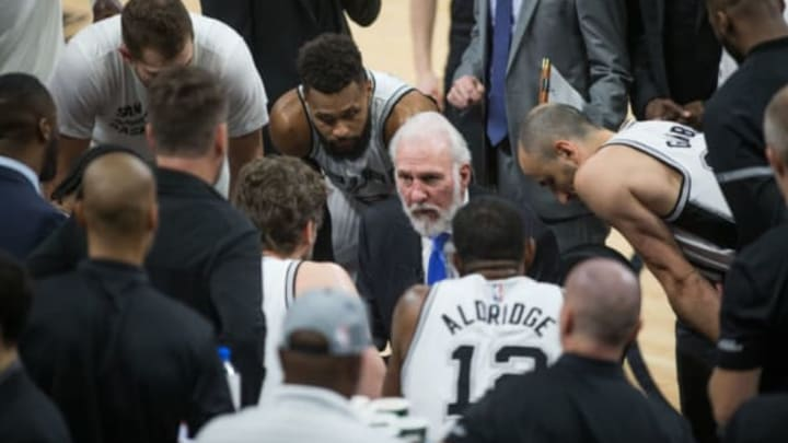 SAN ANTONIO, TX – MARCH 27: Gregg Popovich of the San Antonio Spurs talks with his team during the game against the Cleveland Cavaliers on March 27, 2017 at the AT