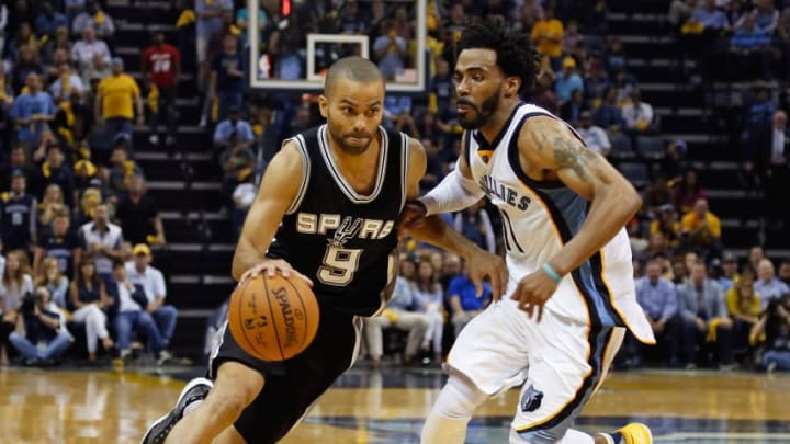 MEMPHIS, TN - APRIL 27: Tony Parker #9 of the San Antonio Spurs drives past Mike Conley #11 of the Memphis Grizzlies during the second half of a 103-96 Spurs victory in Game 6 of the Western Conference Quarterfinals during the 2017 NBA Playoffs at FedExForum on April 27, 2017 in Memphis, Tennessee. NOTE TO USER: User expressly acknowledges and agrees that, by downloading and or using this photograph, User is consenting to the terms and conditions of the Getty Images License Agreement. (Photo by Frederick Breedon/Getty Images)