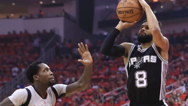 HOUSTON, TX - MAY 11: Patty Mills #8 of the San Antonio Spurs shoots against Patrick Beverley #2 of the Houston Rockets during Game Six of the NBA Western Conference Semi-Finals at Toyota Center. (Photo by Ronald Martinez/Getty Images)