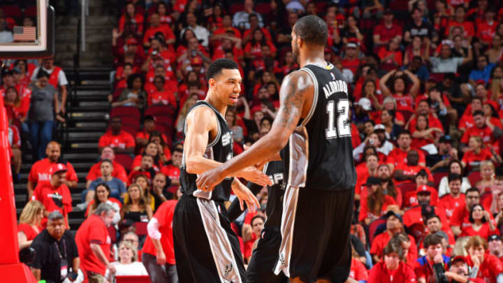 HOUSTON, TX - MAY 11: Danny Green #14 and LaMarcus Aldridge #12 of the San Antonio Spurs high five each other during the game against the Houston Rockets during Game Six of the Western Conference Semifinals of the 2017 NBA Playoffs on May 11, 2017 at the Toyota Center in Houston, Texas. NOTE TO USER: User expressly acknowledges and agrees that, by downloading and or using this photograph, User is consenting to the terms and conditions of the Getty Images License Agreement. Mandatory Copyright Notice: Copyright 2017 NBAE (Photo by Jesse D. Garrabrant/NBAE via Getty Images)