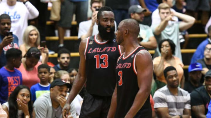 LOS ANGELES, CA – JULY 30: Houston Rockets guards James Harden (13) and Chris Paul (3) talk during a Drew League game at King Drw Magnet High School on July 30th, 2017. (Photo by Brian Rothmuller/Icon Sportswire via Getty Images)
