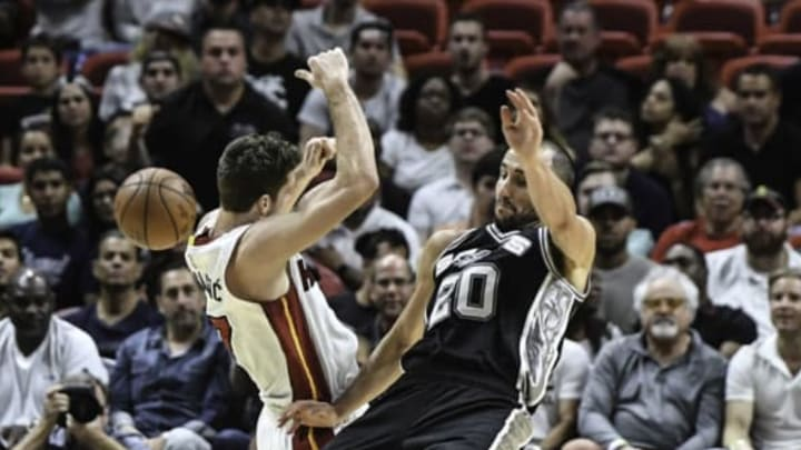 MIAMI, FL – OCTOBER 30: Goran Dragic #7 of the Miami Heat and Manu Ginobili #20 of the San Antonio Spurs in action during a NBA game at American Airlines Arena on October 30, 2016 in Miami, Florida. NOTE TO USER: User expressly acknowledges and agrees that, by downloading and or using this Photograph, user is consenting to the terms and condition of the Getty Images License Agreement. (Photo by Ron Elkman/Sports Imagery/Getty Images)
