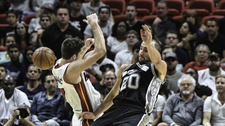 MIAMI, FL - OCTOBER 30: Goran Dragic #7 of the Miami Heat and Manu Ginobili #20 of the San Antonio Spurs in action during a NBA game at American Airlines Arena on October 30, 2016 in Miami, Florida. NOTE TO USER: User expressly acknowledges and agrees that, by downloading and or using this Photograph, user is consenting to the terms and condition of the Getty Images License Agreement. (Photo by Ron Elkman/Sports Imagery/Getty Images)