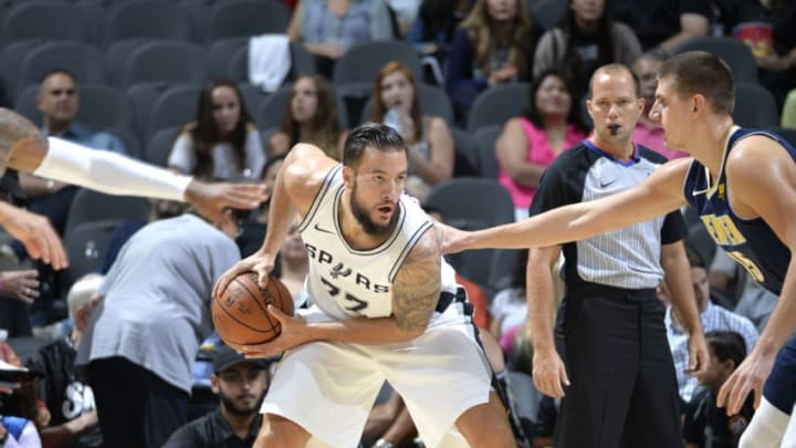 SAN ANTONIO, TX - OCTOBER 8: Joffrey Lauvergne #77 of the San Antonio Spurs handles the ball against the Denver Nuggets during the preseason game on October 8, 2017 at the AT&T Center in San Antonio, Texas. NOTE TO USER: User expressly acknowledges and agrees that, by downloading and or using this photograph, user is consenting to the terms and conditions of the Getty Images License Agreement. Mandatory Copyright Notice: Copyright 2017 NBAE (Photos by Mark Sobhani/NBAE via Getty Images)