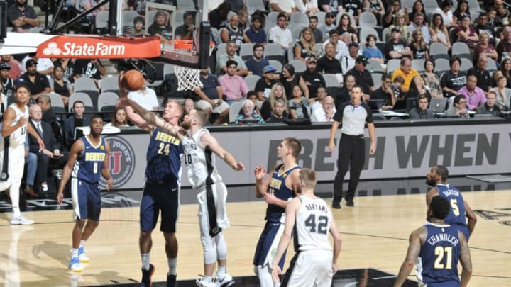 SAN ANTONIO, TX - OCTOBER 8: Mason Plumlee #24 of the Denver Nuggets shoots the ball against the San Antonio Spurs during the preseason game on October 8, 2017 at the AT&T Center in San Antonio, Texas. NOTE TO USER: User expressly acknowledges and agrees that, by downloading and or using this photograph, user is consenting to the terms and conditions of the Getty Images License Agreement. Mandatory Copyright Notice: Copyright 2017 NBAE (Photos by Mark Sobhani/NBAE via Getty Images)