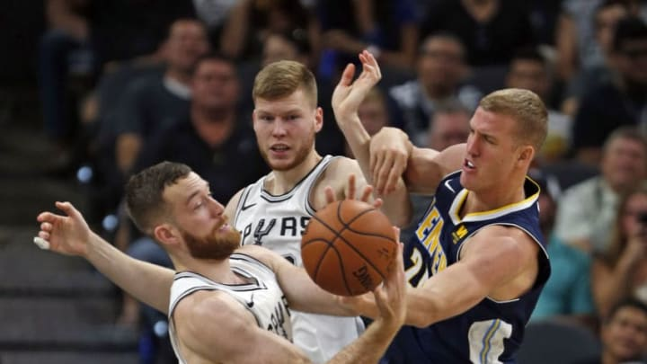 SAN ANTONIO,TX - OCTOBER 8: Matt Costello #10 of the San Antonio Spurs battles Mason Plumlee #24 of the Denver Nuggets at AT&T Center on October 8, 2017 in San Antonio, Texas. NOTE TO USER: User expressly acknowledges and agrees that , by downloading and or using this photograph, User is consenting to the terms and conditions of the Getty Images License Agreement. (Photo by Ronald Cortes/Getty Images)